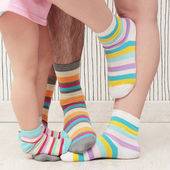 Family in socks — Stock Photo
