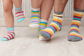 Family in socks — Stock Photo