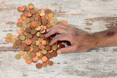 Poor and coins — Stock Photo