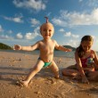 Two sisters on a beach — Stock Photo #20117191