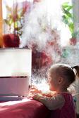 Baby and humidifier — Stock Photo