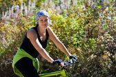 Woman on bike — Stock Photo