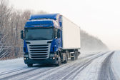 Truck on a winter road — Stock Photo