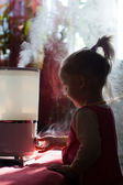 Baby and humidifier — Stock Photo