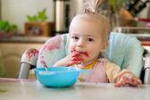 Girl eating jam — Stock Photo