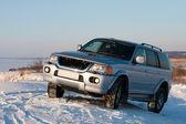 Car on snowy hill — Stock Photo
