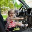 Little girl in car — Stock Photo