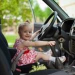 Little girl in car — Stock Photo #30142603