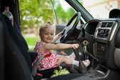 Little girl in car — Stock Photo