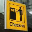 Check-in sign at airport — Stock Photo
