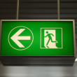 Green emergency exit sign — Stock Photo