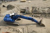 Blue excavator at constuction site — Stock Photo