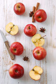 Red apple on wooden table — Stock Photo