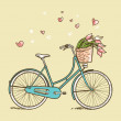 Vintage bicycle with flowers - Zdjęcie stockowe