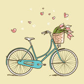 Vintage bicycle with flowers — Stock Photo