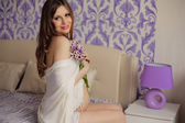 Beautiful pregnant woman with tulips waiting a baby — Stock Photo