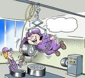 Un mécanicien transportant des pneus avec un ascenseur spécial — Photo