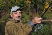 老渔夫与纺纱杆 — 图库照片