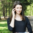 Stock Photo: Beautiful girl talking by mobile phone