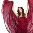 Stock Photo: Womin red dress flying on wind isolated