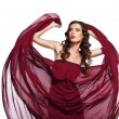 Dancing woman in red dress flying on wind — Stock Photo