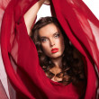 Woman in red dress flying on wind. Close-up — Stock Photo