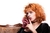 Girl with red hair making a hush gesture — Stock Photo