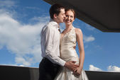 Happy bride and groom at the wedding walk — Stock Photo