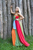 Sexy woman outdoor with nice colorful dress — Stock Photo