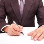 pracownik firmy podpisanie umowy na biały — Zdjęcie stockowe #31396983