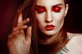 Beautyful woman with creative make-up over dark — Stock Photo