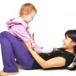 Mother with the baby doing exercises over white — Stock Photo