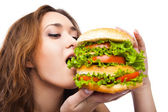 Happy Young Woman Eating big yummy Burger isolated — Stock Photo