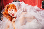 Sleeping Woman in white wedding dress. Bathroom — Stock Photo