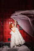 Dancing Woman in white wedding dress. Bathroom — Foto Stock