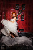 Dancing Woman in white wedding dress. Bathroom — Stock Photo