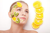 Smiling woman with fruit mask on her face isolated — Stock Photo