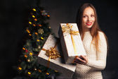 Christmas. smiling woman with many gift boxes — Stock Photo