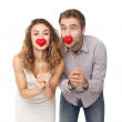Couple holding red hearts — Stock Photo #38723439