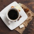 Coffee cup and beans, cinnamon on wooden table — Stock Photo #38861755