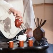 Young man holds a Chinese tea ceremony — Stock Photo