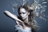 Young, beautiful blonde woman with blowing hair — Foto Stock