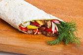 Beef burrito with peppers, onion and tomato — Stock Photo