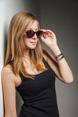 Beautiful young model with big glasses-close up — Stock Photo