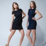 Two beautiful woman posing in dresses — Stock Photo