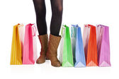 Picture of womans long legs with shopping bags — 图库照片