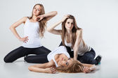 Three modern style dancers woman over gray — ストック写真