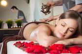 Woman enjoying Ayurveda oil massage in spa — Stock Photo