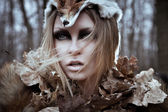 Wild beauty tribal woman in forest — Stock Photo