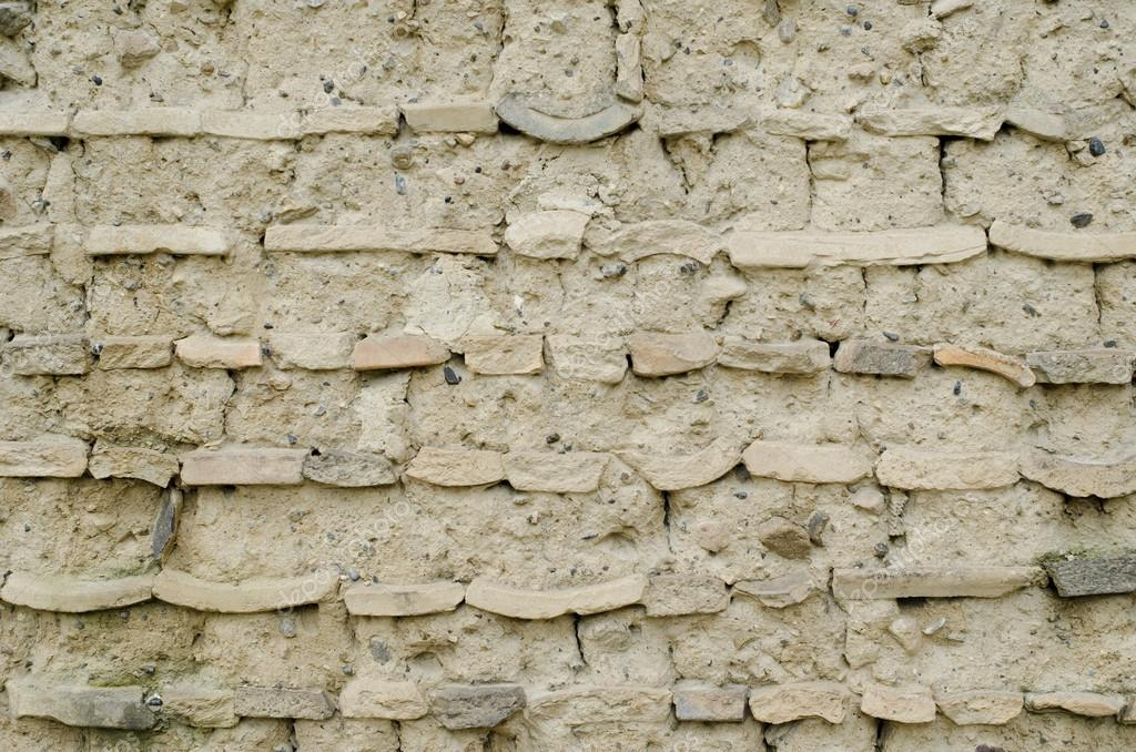 Detail of an old clay wall in Japan, background structure  Stock Photo #12765698